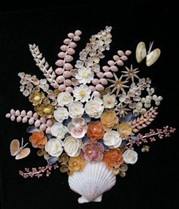 Shell picture of flowers in vase